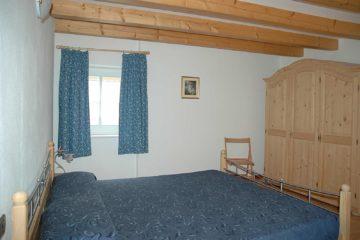 camera matrimoniale appartamento baselga di pinè